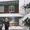 JOED VIERA/STAFF PHOTOGRAPHER-Lockprot, NY- John Dussault walks through the snow to his car after purchasing groceries at Niagara Produce.
