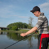 JOED VIERA/STAFF PHOTOGRAPHER-Lockport, NY-Ed Carroll fishes at Nelson C. Goehle Marina.