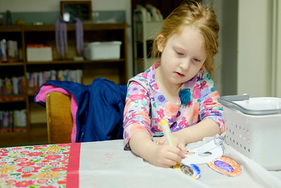 JOED VIERA/STAFF PHOTOGRAPHER-Lockport, NY-Katelyn Hoover, 4, makes an easter bunny masks during craft time at the Lockport Library.