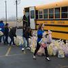 JOED VIERA/STAFF PHOTOGRAPHER-Ridge Road Express employees pack a school bus full of over a hundred easter baskets they collected to donate to John R. Oishei Childrens Hospital in Buffalo.