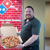JOED VIERA/STAFF PHOTOGRAPHER-Lockport, NY-Dominos franchise owner Allan Erwin shows off a Ultimate Pepperoni Pizza at the recently opened restaurant on Beattie Avenue.