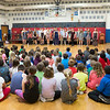JOED VIERA/STAFF PHOTOGRAPHER-Newfane, NY- Newfane Elementary students listen to the Newfane High School Vocal Jazz Ensemble perform during their last concert of the year in the Elementary School gym