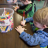 JOED VIERA/STAFF PHOTOGRAPHER-Sylas Fay, 5, painted a popsicle-stick dragonfly in the arts and crafts class at the YMCA's Easter Break Day Camp on Wednesday.