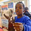 JOED VIERA/STAFF PHOTOGRAPHER-Lockport, NY-Charles Upson second-grader Robert Wright, 8, reads about Dr. Martin Luthur King in Robert Carlin's class Wednesday afternoon. Wright along with his classmates painted pictures and learned about the civil rights leader in preperation for today's holiday.