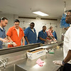 Joed Viera/Staff Photographer- Chef Bobby anderson directs the line of inmates in the Niagara County Jail kitchen during F-Bites.