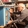 Joed Viera/Staff Photographer-Paul Lyons installs a door on his third Little Free Library in his shop.