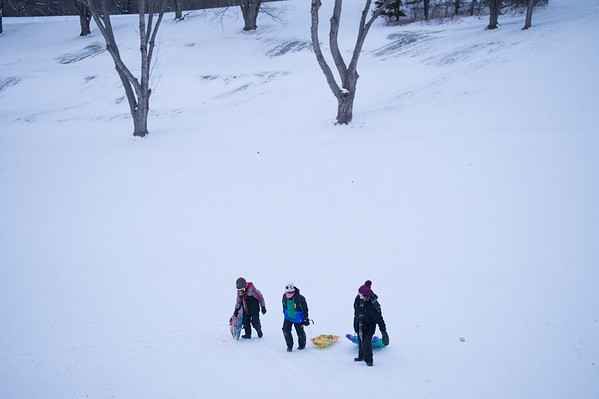 JOED VIERA/STAFF PHOTOGRAPHER-Lockport, NY- Joshua McClain,11,  Jack Keleher,11, and Jessica McClain, 14, climb up after sledding down a hill at Lockport Town and Country Club.