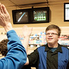 Joed Viera/Staff Photographer-Newfane High School unified bowler Matt  Murray gets a high five after he landed a strike during the section VI unified sports bowling tournament at Brad Angelo Lanes.