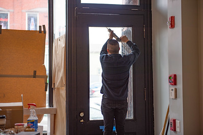 JOED VIERA/STAFF PHOTOGRAPHER- Buffalo, NY-repairs a windows at his new restaurant Billyclub in Allen Street.