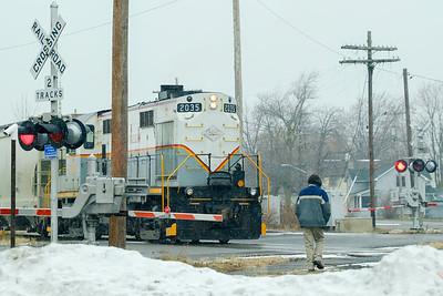 Joed Viera/Staff Photographer-Lockport ,NY-A man waits for a train to cross an icy Niagara Street.