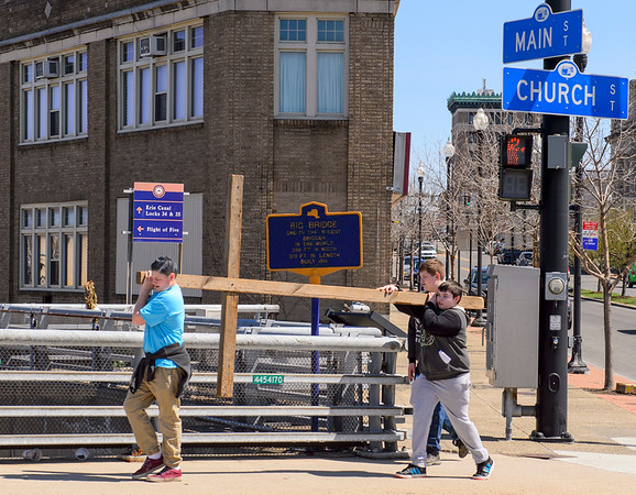 JOED VIERA/STAFF PHOTOGRAPHER-Lockport, NY-Tony Shay, 14, Kevin Gamache, 13, and Leland Glena, 14, carry a cross across the Big Bridge on Church Street during the crosswalk from Lockport United Church of Christ to First Presbyterian Church.