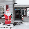 Joed Viera/Staff Photographer-Snow falls over the Christmas decorations of this Chestnut Street home.