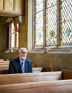 JOED VIERA/STAFF PHOTOGRAPHER-Lockport, NY- Rev. Dr. Duane Priset sits at Emmanuel United Methodist Church.