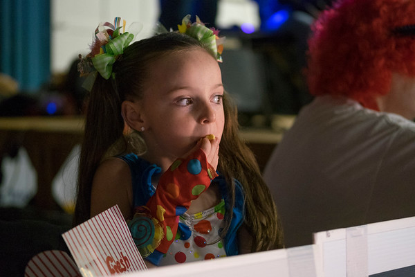 Joed Viera/Staff Photographer-Lillianna Gagliano munches on popcorn while watching Nels Ross perform.