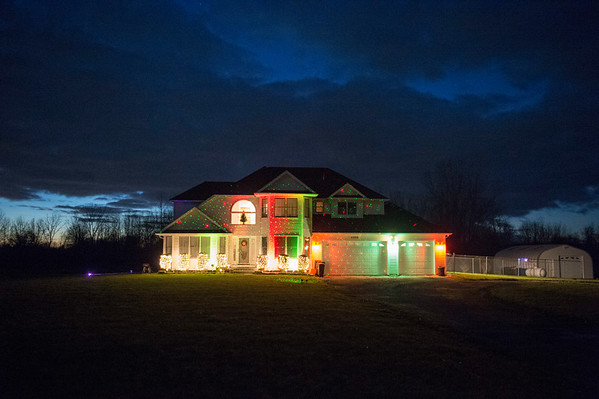 Joed Viera/Staff Photographer-Christmas lights and laser beams brighten up this Beebe Road home in Wilson.