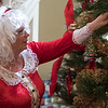 Joed Viera/Staff Photographer- Mrs. Clauss places ornaments on the Kenan House Christmas Tree.  Mrs Clauss will be joined by her husband at the Kenan Center's annual Holiday Gift Show that takes place this weekend.