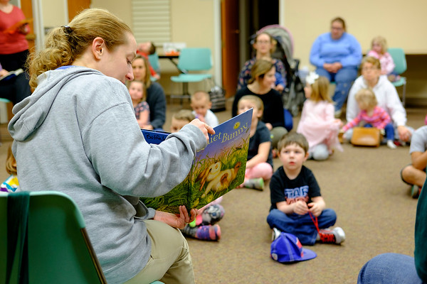 """JOED VIERA/STAFF PHOTOGRAPHER-Lockport, NY-Buffalo Zoo Outreach Program specialist Robin Sanecki read """"Quiet Bunny"""" to a packed Lockport Library Community Room during the Zootales program. Afterwards children had the opportunity to pet Benjamin, a holland lop rabbit."""