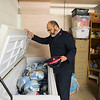 Joed Viera/Staff Photographer- <br /> Major Jose Santiago Looks over turkeys donated to the Sister Mary Loretto Soup Kitchen at the Salvation Army Monday morning.