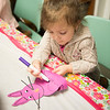 JOED VIERA/STAFF PHOTOGRAPHER-Lockport, NY- Maggie Masters, 3, puts together an easter bunny hat during crafts at the Lockport Public Library.