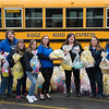 JOED VIERA/STAFF PHOTOGRAPHER-Ridge Road Express employees Darcy Croft, Kathleen Graham, Wendy Prosser, Lauren Rick, Brandi Newman, Lisa Szeakowski, Diane Goers and Robyn Heyn outside of the Lockport Junction Road bus company with over a hundred easter baskets headed to John R. Oishei Childrens Hospital in Buffalo.