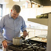 Joed Viera/Staff Photographer- <br /> Pastor Hardy cooks soup in the Church Kitchen.