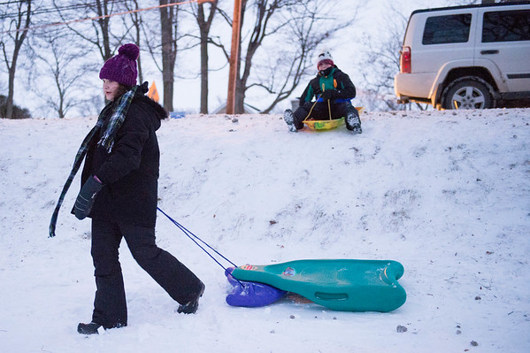 JOED VIERA/STAFF PHOTOGRAPHER-Lockport, NY- Jessica McClain, 14, and Jack Keleher,11, get ready  to sled down a hill at Lockport Town and Country Club.