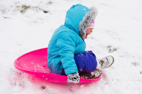 Joed Viera/Staff Photographer- Marissa Marino, 3, takes a sled down a hill at Lockport Town and Country club.