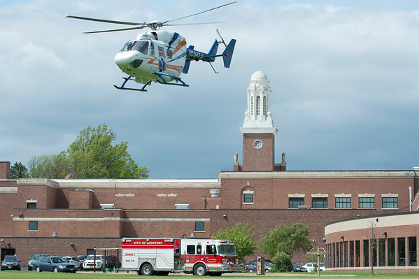 JOED VIERA/STAFF PHOTOGRAPHER-Lockport, NY-Mercy flight carrys an injured child that fell from the second story of Emmett Belknap Intermediate School Monday afternoon.