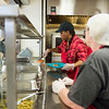 Joed Viera/Staff Photographer- <br /> Rebia Maroney and Annette Wittcop serve lasagna at the Sister Mary Loretto Soup Kitchen at the Salvation Army Monday morning.