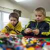 JOED VIERA/STAFF PHOTOGRAPHER-Remington, 5, Trever Mietlowski, 10, take part in LEGO Club at the Royalton Hartland Community Library Wednesday afternoon.