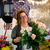 Joed Viera/Staff Photographer-The Flower Barn owner Elizabeth Copella prepares flower arrangements for Valentines Day.  It's not too late to get your loved one an arrangement, the shop  is extending it's hours today to 6PM.  The Flower Barn is located at 7716 Rochester Road in Gasport.