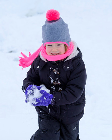JOED VIERA/STAFF PHOTOGRAPHER-Lockport, NY-Nora Luskin, 4, gets ready to throw a snowball at a photographer Friday morning.