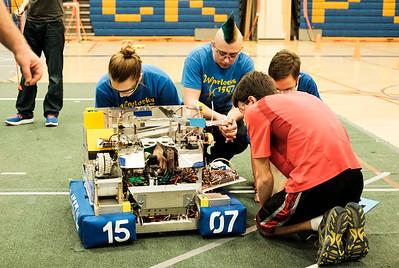 Lockport High School's FIRST robotics team the Warlocks' Keirstan Farina, 16, Oscar Handley, 17, Jeremy Stoddard, 14, and Antonio Faraci, 18, work on their robot before a presentation in the school gym on Monday.