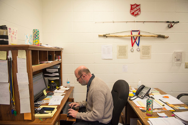 Joed Viera/Staff Photographer-Chris Gresart works in his office at the Salvation Army.