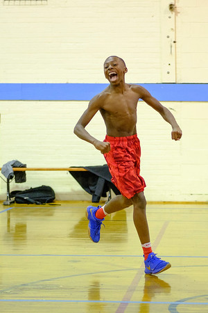 JOED VIERA/STAFF PHOTOGRAPHER-Lockport, NY-Kai Tran 14 celebrates a layup during a shirts vs skins basketball game at the YMCA Wednesday evening.