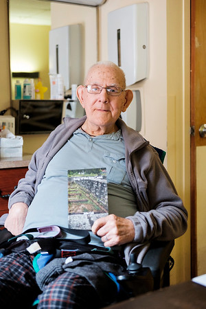"""JOED VIERA/STAFF PHOTOGRAPHER-Gasport, NY-Author John Cull holds up his latest publication """"Song of the Erie Canal"""" in his residence at Absolut Care of Gasport."""