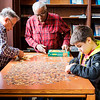 JOED VIERA/STAFF PHOTOGRAPHER-Lockport, NY-Horace Wolcott, Buford Corbin and Cedric Busch 10 put together a 1000 piece jigsaw puzzle in the Wheeler Room of the Lockport Public Library.