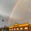 Joed Viera/Staff Photographer-A rainbow appears over Wrights Corners Fire Company during Thursday's sunset.