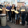 JOED VIERA/STAFF PHOTOGRAPHER-Lockport, NY-Kathy Jackson, Matt Stawicki,   Mary Brennan-Taylor, Nolyn Brunner and Charlie Haungs hold up boxes of winter boots donated by the Lockport Outdoor Store to the YWCA.