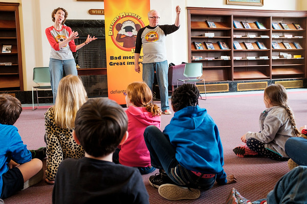 JOED VIERA/STAFF PHOTOGRAPHER-Lockport, NY- Karen Eichler and Andy Spragge of Defiant Monkey play out an improvised scene for kids in the Wheeler Room of the Lockport Public Library.
