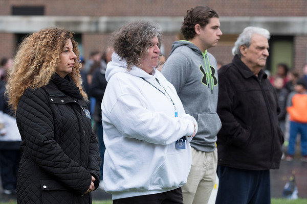 Joed Viera/Staff Photographer-Christine Fragale, Tammy Parete, John-Anthony Parete and Anthony Parete watch a flag raising ceremony to honor fallen Buffalo Police Officer Craig Lehner at Emmet Belknap Monday morning.