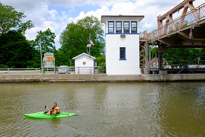 JOED VIERA/STAFF PHOTOGRAPHER- A kayaker rows towards the Lockport locks on the Erie Canal.