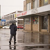 JOED VIERA/STAFF PHOTOGRAPHER-Christopher Boone braves the rain on Washburn Street while deciding on where to have lunch Thursday afternoon.