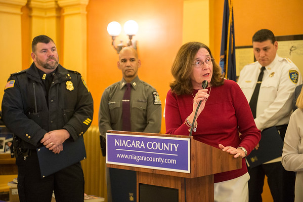 Joed Viera/Staff Photographer-Mary Brennan-Taylor thanks law enforcement officers at a Lockport Blue ceremony at the Niagara County Courthouse. At the event the Legislature along with State Senator Robert Ortt, State Assemblyman Mike Norris and Mayor Anne McCaffrey presented NY State Police, the Niagara County Sheriffs Office and the Lockport Police Department with various proclamations declaring November 2017 Lockport Blue Month.