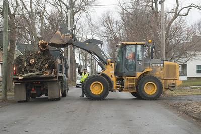 JOED VIERA/STAFF PHOTOGRAPHER- City crews pack the back of a dump truck with fallen tree limbs on Vine Street Wednesday afternoon. High winds caused a number of fallen trees and power outages across the county.