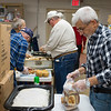 Joed Viera/Staff Photographer- <br />  Al Sammarco makes stuffing for the Salvation Army's Thanksgiving day feast at the Sister Mary Loretto Soup Kitchen Monday morning. Sammarco is one of the founders of the yearly tradition.