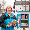 Joed Viera/Staff Photographer-Renny Staples shows off the Little Free Library installed at Washburn Street.