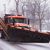 Joed Viera/Staff Photographer- A Niagara County snow plow drives down Ontario Street.