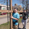 Tony Shay and Leland Glena, both 14, carry a cross along East Avenue during the crosswalk from Lockport United Church of Christ to First Presbyterian Church on Church Street.