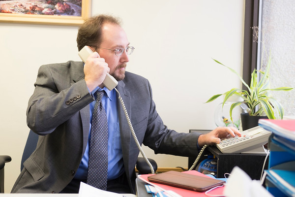JOED VIERA/STAFF PHOTOGRAPHER-Lockport, NY- Probation officer Michael Schuler works in his office.